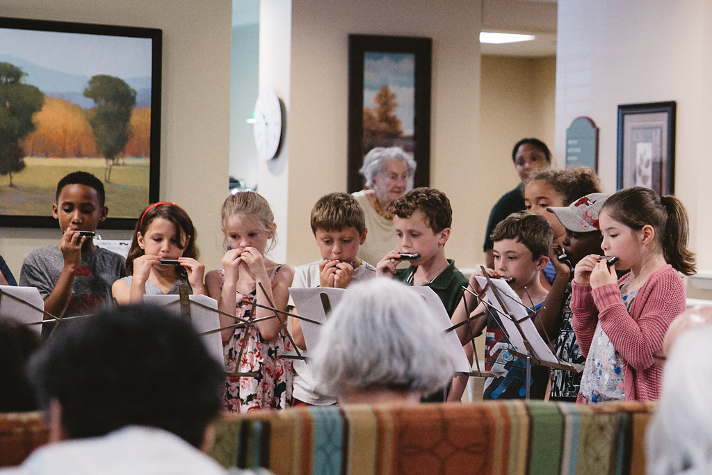 Longfellow 2nd graders bring music to Belmont Village